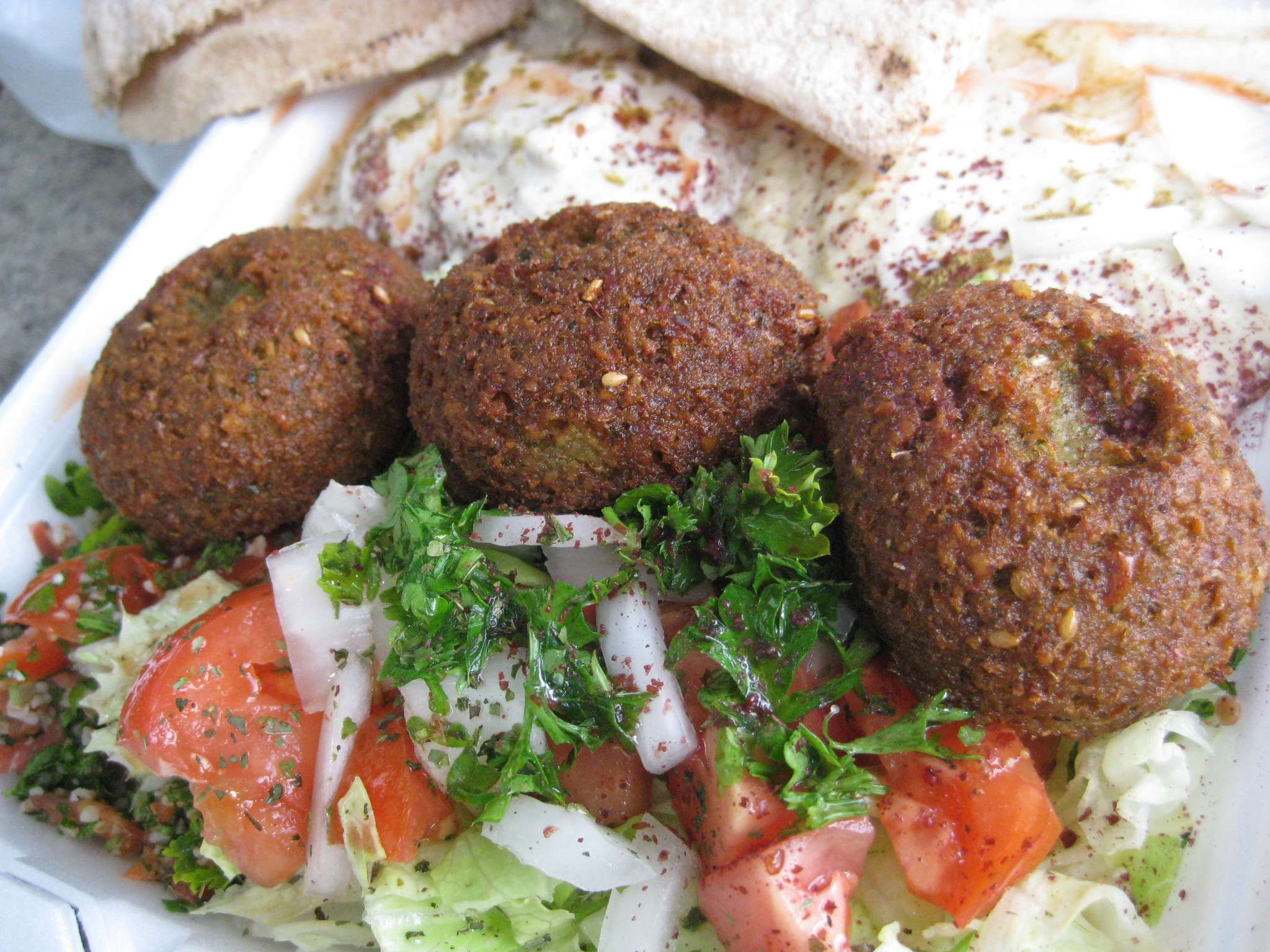 For $7 I received, 3 rocky mountain oyster sized falafel, hummus, baba ...